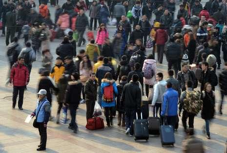 Keramaian saat 'mudik' di Beijing (Mark Ralston/AFP/Getty Images