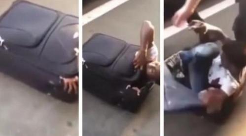 Seorang pria Eritrea setinggi 1,8 meter ditangkap petugas karena mencoba memasuki Swiss secara ilegal dengan bersembunyi di dalam koper. Foto : The Telegraph | YouTube.