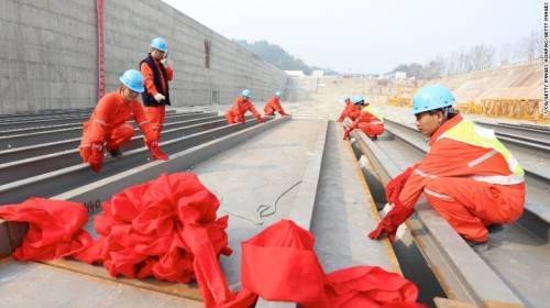 Workers lay the keel of a replica Titanic in China's Sichuan province